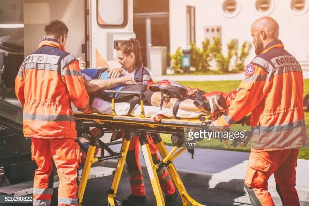 Paramedic team helping injured person