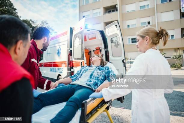 paramedic team pushing stretcher - victim stock pictures, royalty-free photos & images