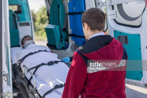 paramedic team pushing stretcher - gory car accident photos stock pictures, royalty-free photos & images
