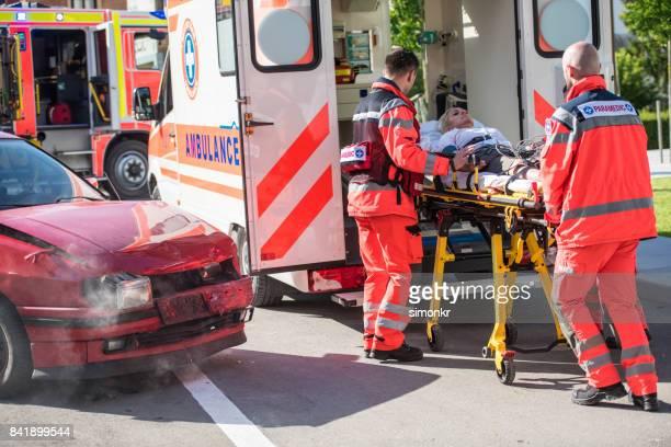 Paramedic team pushing stretcher