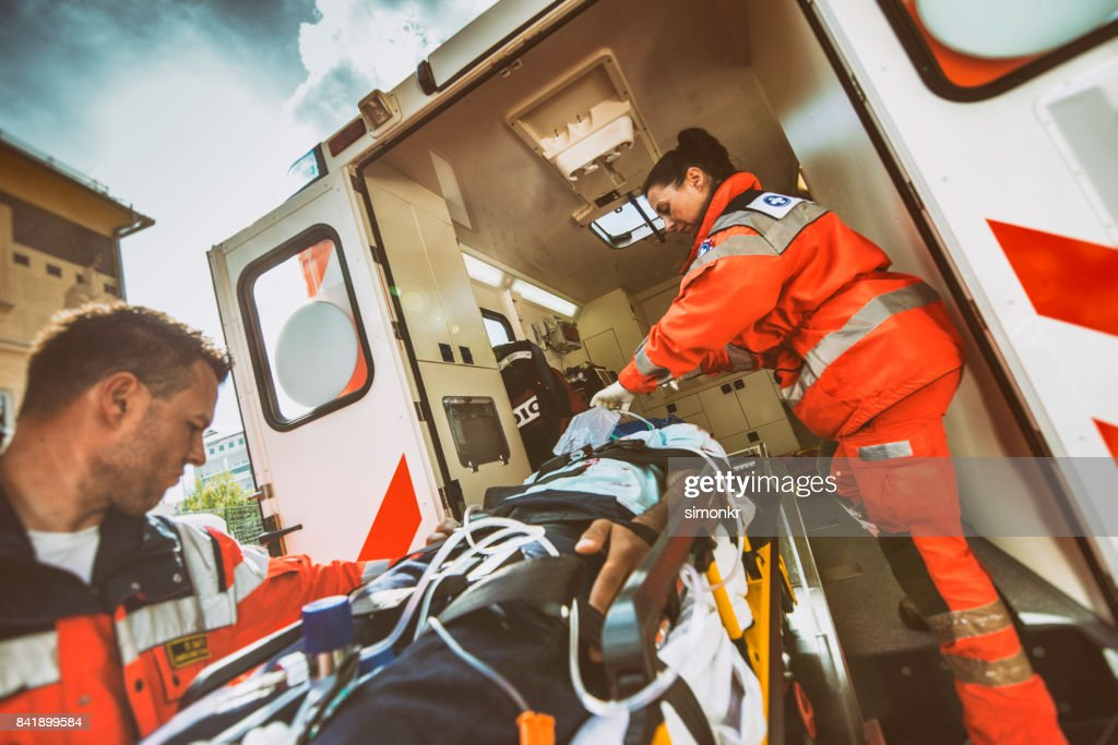 Paramedic team pushing stretcher : Stock Photo