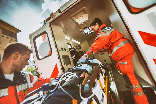 Paramedic team pushing stretcher 841899584
