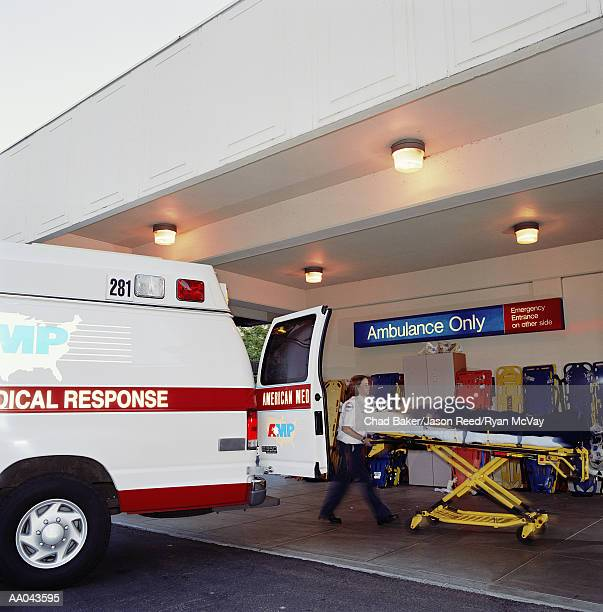Paramedic transporting patient to emergency room from ambulance