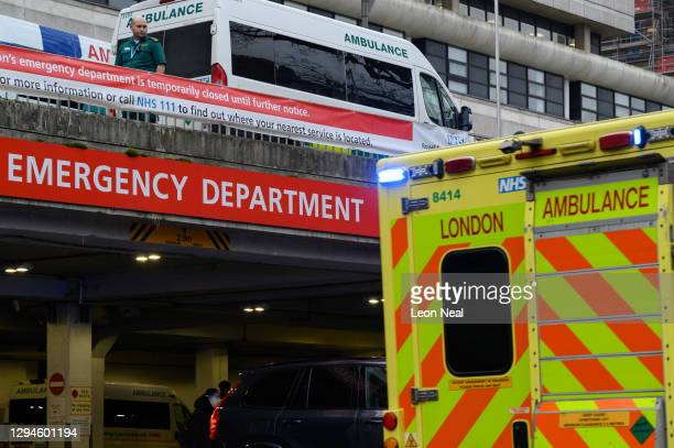 Paramedic watches as an ambulance on an emergency call drives past the Royal Free hospital, on January 05, 2021 in London, England. British Prime...