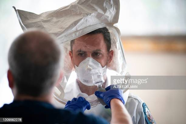 A Paramedic with Anne Arundel County Fire Department tests his N95 mask at the start of his 24hour shift on April 9 in Glen Burnie Maryland /...