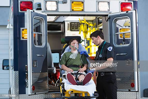 Paramedic with child on stretcher