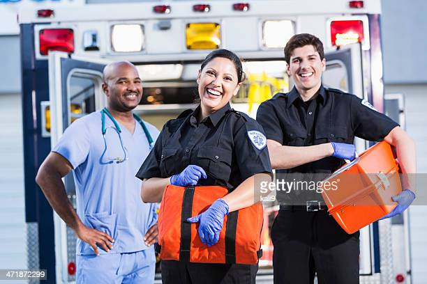 Paramedics and doctor outside ambulance