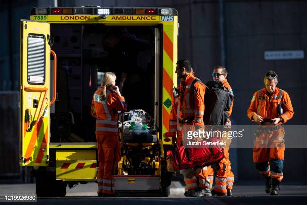 Paramedics and Doctors from the London Air Ambulance prepare outside the Royal London Hospital on April 20, 2020 in London, England. The British...