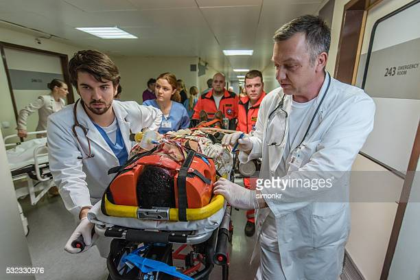 paramedics and doctors in hospital - hospital gurney stock pictures, royalty-free photos & images