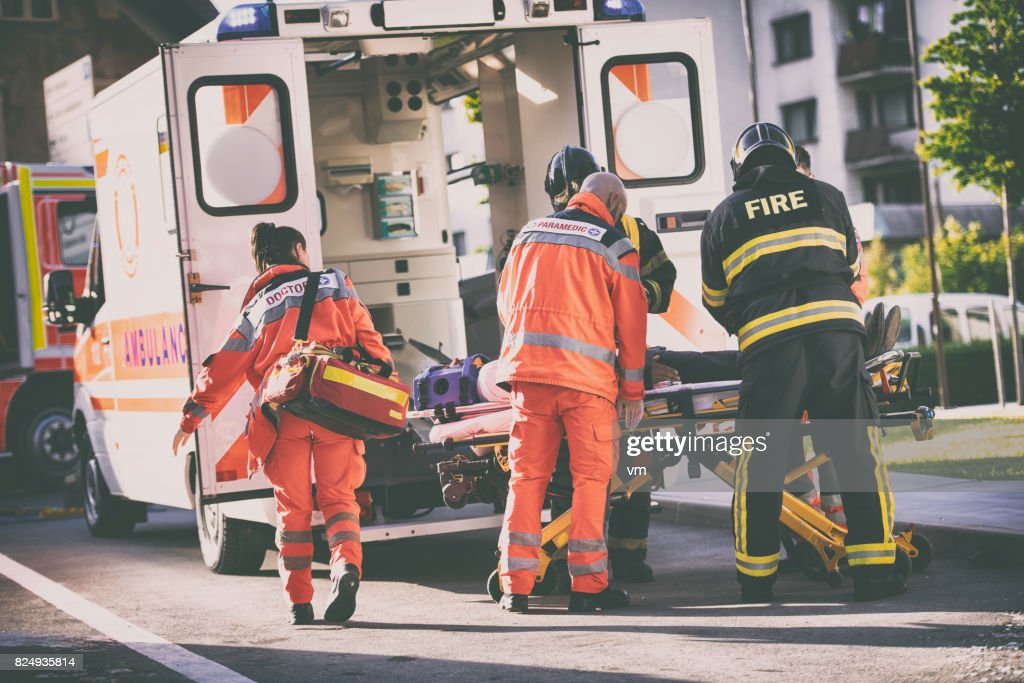 Paramedics and firefighters : Stock Photo