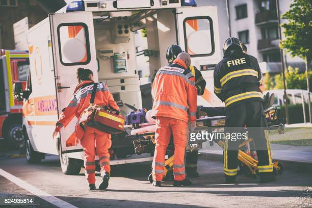 paramedics and firefighters - rescue worker stock pictures, royalty-free photos & images