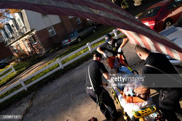 Paramedics and firefighters with Anne Arundel County Fire Department prepare to transport a patient to the hospital as first responders respond to a...