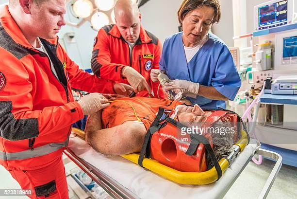 Paramedics and nurse in emergency room