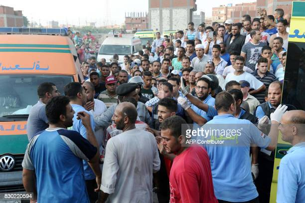 Paramedics arrive at the site of a train collision in the area of Khorshid in Egypts Mediterranean city of Alexandria on August 11 2017 At least 36...