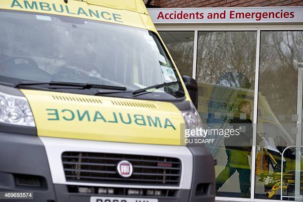 Paramedics arrive with a patient at the Accident and Emergency department of the 'Royal Albert Edward Infirmary' in Wigan north west England on April...