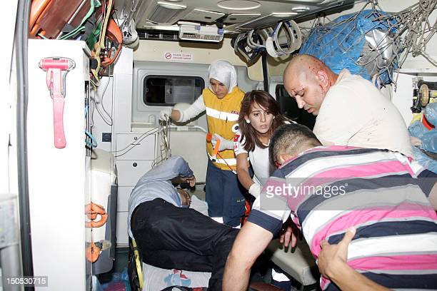 Paramedics assist people injured after a car bomb went off on August 20 2012 in the centre of Turkey's southeastern city of Gaziantep At least seven...