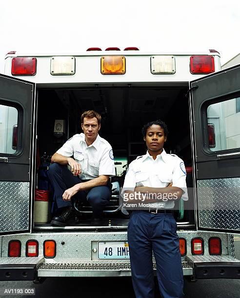 Paramedics at rear of ambulance