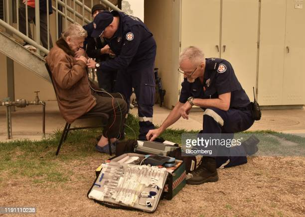 Paramedics attend to a person with breathing difficulties in Batemans Bay New South Wales Australia on Tuesday Dec 31 2019 Australia scrambled its...