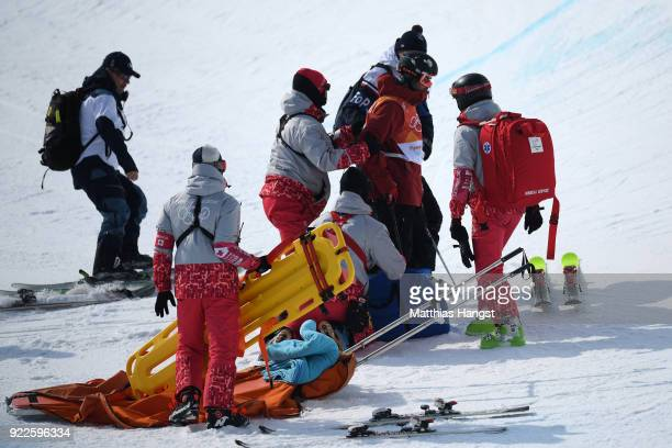 Paramedics attend to Kevin Rolland of France after he crashed during the Freestyle Skiing Men's Ski Halfpipe Final on day thirteen of the PyeongChang...