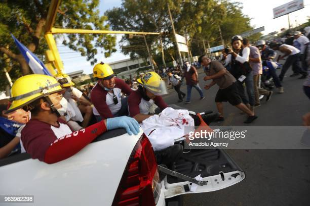 Paramedics carry a corpse during the march of mothers' day called in memory of the dead and disappeared during the 42 days of crisis that has...