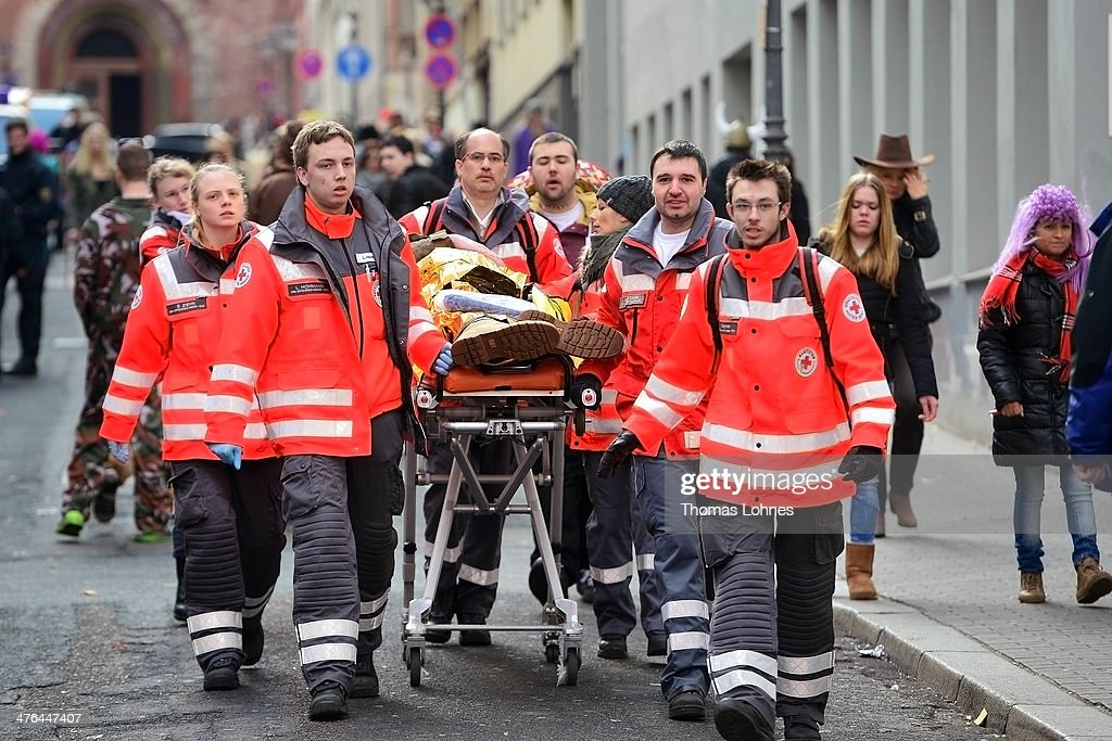 Paramedics carry a man on a stretcher during the Monday carnival parade on March 3, 2014 in Mainz, Germany. Rose Monday is the highpoint of the annual carnival season in the region between Mainz, Cologne and Dusseldorf, where the carnival has been an annual tradition since 1823 and celebrates free-spirited merrymaking before the beginning of Lent.