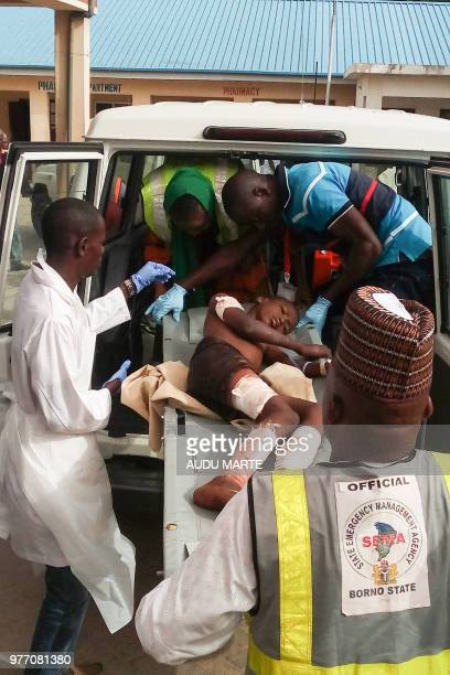 Paramedics carry a young victim of a blast at the hospital in Maiduguri on June 17 2018 Suspected Boko Haram jihadists killed at least 31 people in a...