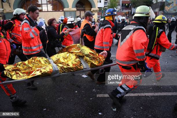 Paramedics carry an injured man away during the Welcome to Hell protest march on July 6 2017 in Hamburg Germany Leaders of the G20 group of nations...