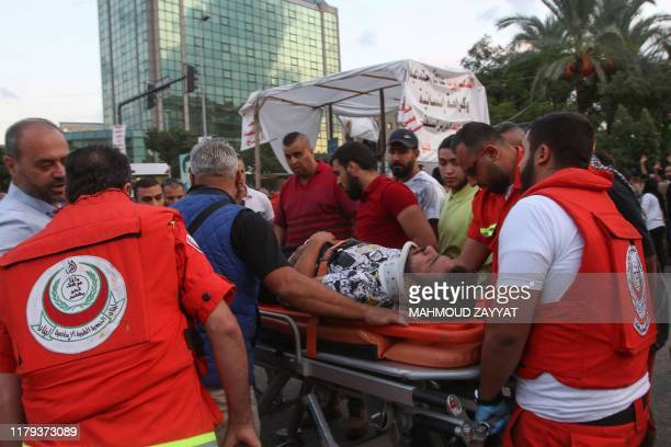 Paramedics carry away an injured protester during ongoing antigovernment demonstrations in Lebanon's southern city of Sidon on November 1 2019