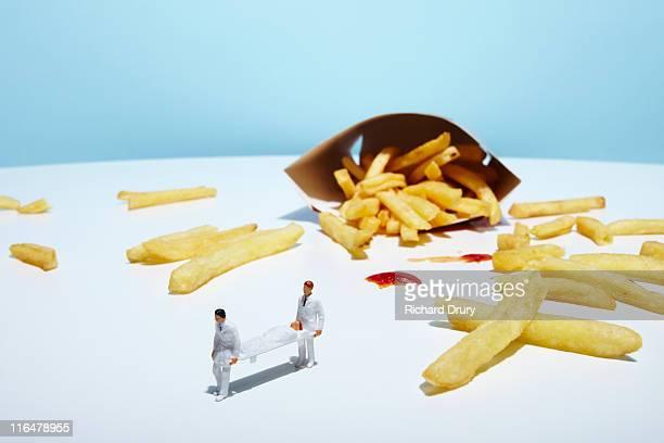 Paramedics carrying man near fries