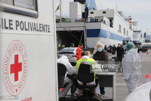Paramedics check passengers disembarked from the Catania Grimaldi ferry that brought home 105 Italian citizens who were evacuated from Tunisia. In...