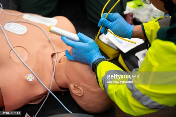 Paramedics demonstrate an emergency medical procedure on a mannequin during training on December 4 2019 in Cardiff United Kingdom