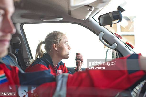 paramedics driving to emergency in ambulance - 救助隊 ストックフォトと画像