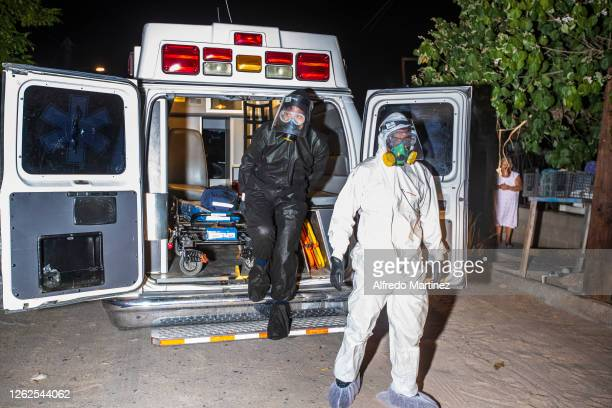 Paramedics from the Calafia group arrive at a house to deliver a food pantry to a woman whose son has COVID-19 on July 28, 2020 in La Paz, Mexico....