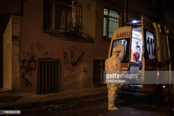 Paramedics from Turkey's 112 Emergency Healthcare services work on a suspected Covid-19 positive patient before transporting him to hospital on...