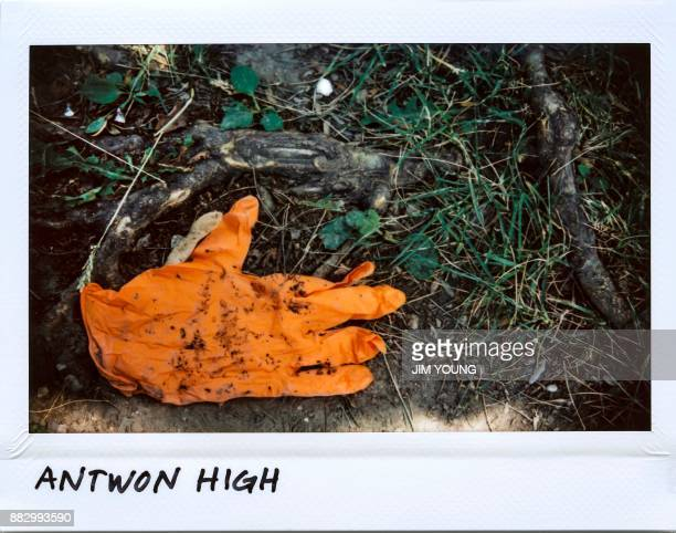 A paramedic's glove is seen on the ground at 200 block of South Hoyne Avenue in Chicago Illinois where Antwon High 26yearold on June 21 2017 High...