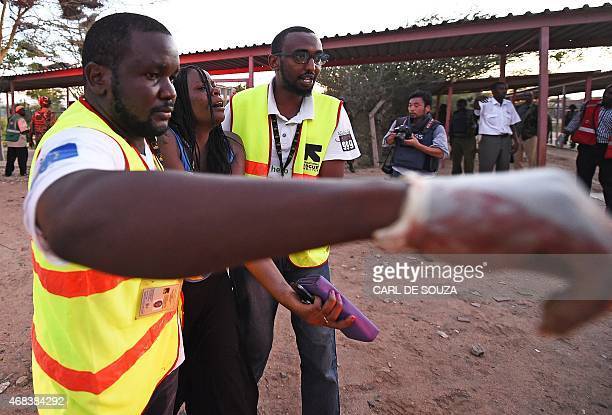 Paramedics help a student who was injured during an attack by Somalia's Al-Qaeda-linked Shebab gunmen on Garissa University campus on April 2, 2015....