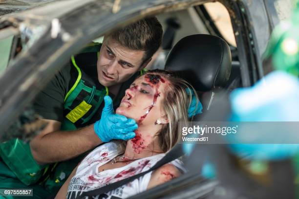 paramedics helping car crash victim after accident - bloody car accidents stock pictures, royalty-free photos & images