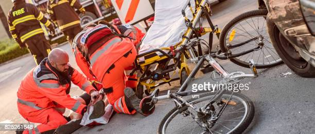 Paramedics helping injured cyclist