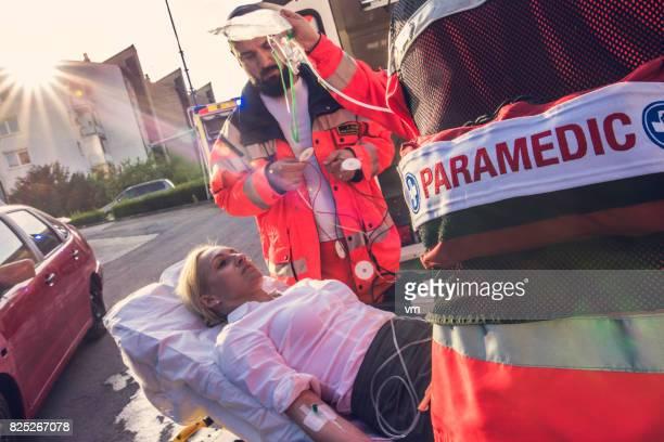 Paramedics helping injured woman