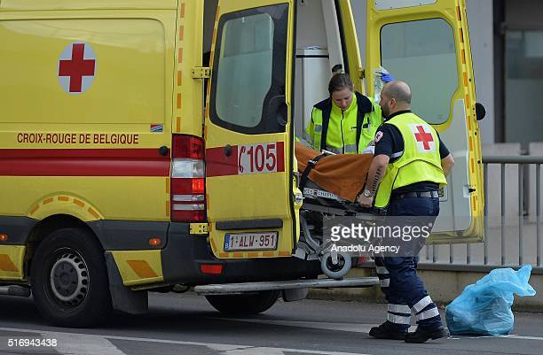 Paramedics hospitalize the terrorist attack's wounded victim at UCL SaintLuc in Brussels Belgium on March 22 2016 At least 34 people were killed and...