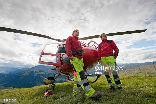 paramedics in front of rescue helicopter - medevac stock photos and pictures