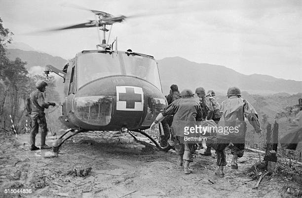 Paramedics load wounded paratroopers of the 101st Airborne Division into a UH1 Iroquois also known as a Huey following fierce fighting on Hamburger...