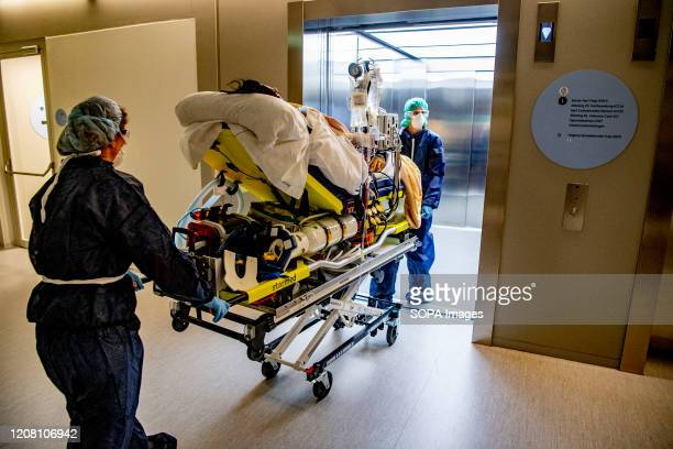 Paramedics move a patient on a stretcher to be transferred to another hospital due to overload amid Coronavirus outbreak The capacity of Brabant...