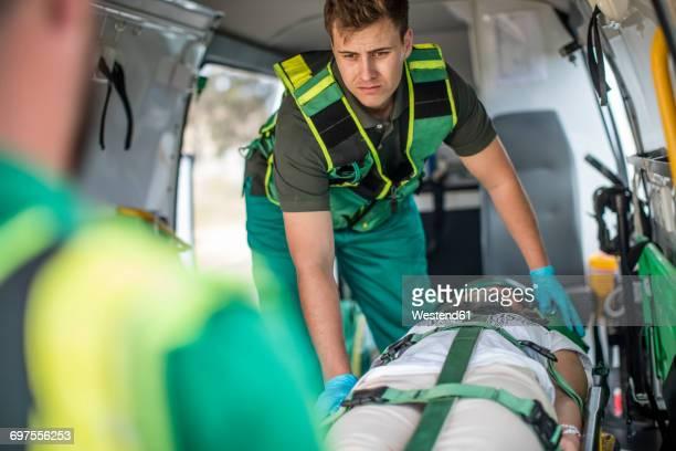 Paramedics moving car crash victim on stretcher
