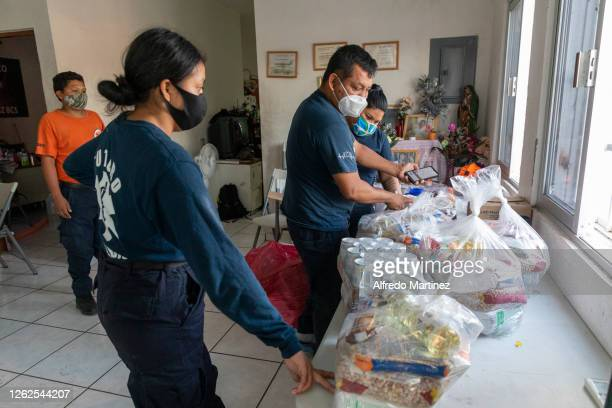 Paramedics of the Calafia group prepare food pantries on July 28, 2020 in La Paz, Mexico. Many Mexican States remain in orange emergency while in...