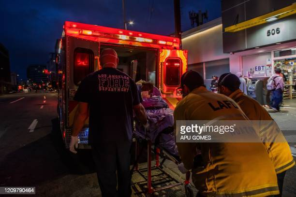 TOPSHOT Paramedics of the LAFD Station No9 wear a face mask as a preventive measure against the spread of the COVID19 novel coronavirus from a...