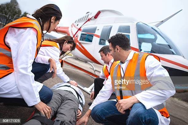 paramedics on an air ambulance - helicopter photos stock pictures, royalty-free photos & images