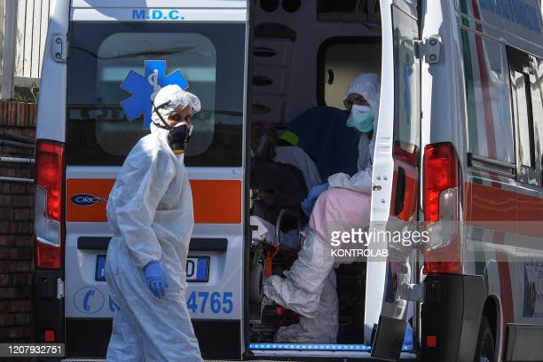 Paramedics open an ambulance with a Coronavirus COVID19 patient at the emergency room of the Cotugno hospital