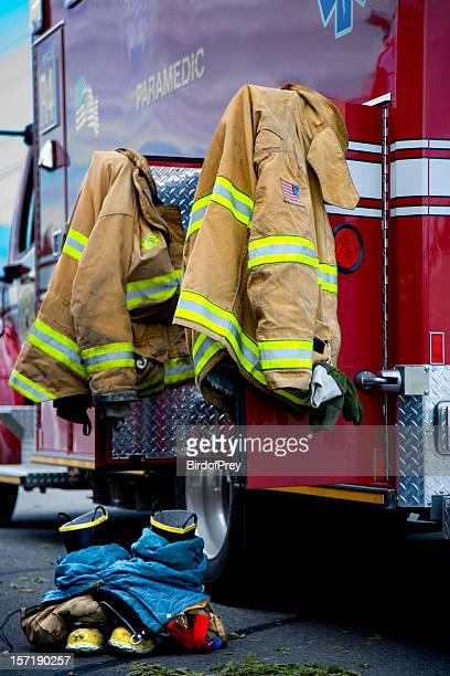 paramedics - fire protection suit stock photos and pictures