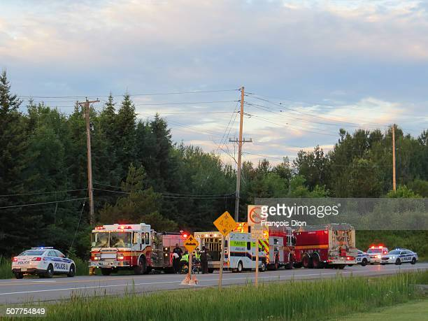 CONTENT] Paramedics police and firefighters on site of a car accident early in the morning